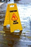 Caution wet floor sign. Caution wet floor yellow sign Stock Images
