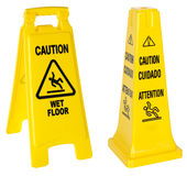 Caution: Wet Floor signs. Two Caution: Wet Floor signs isolated on white with individual clipping paths Stock Images