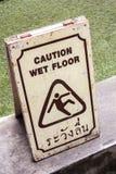 Caution wet floor. Symbol caution wet floor in thailand Stock Images