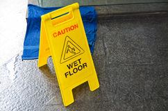 Caution wet floor warning sign Stock Photos