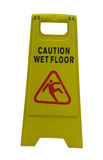 Caution wet floor. Yellow sign caution wet floor isolated on white background Stock Photography