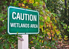 Caution Wetlands Area Sign. In Park Royalty Free Stock Photo