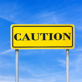 Caution written on road sign Royalty Free Stock Photos
