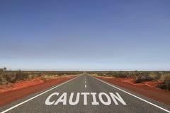 Caution written on the road stock illustration