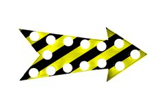 Caution yellow and black stripes painted over a vintage bright and colorful illuminated metallic display arrow sign with bulbs. Caution yellow and black stripes Stock Photo