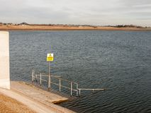 Caution yellow deep water sign submerged structure nature reserv. E; essex; england; uk Royalty Free Stock Photography