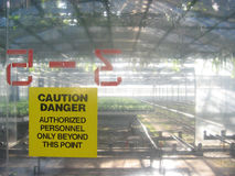 Caution yellow sign at commercial greenhouse Royalty Free Stock Photography