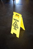 Caution yellow sign for wet floor warning on a floor Royalty Free Stock Image