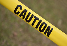 Caution yellow tape. Close up of the caution yellow tape royalty free stock photography