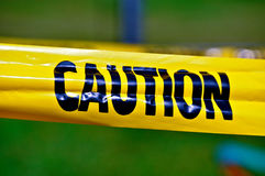 Caution yellow tape with black letters Royalty Free Stock Image
