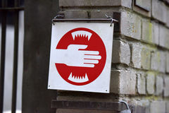 Cautionary at the zoo, it is recommended not to stick your hands in the cage. Estonia, Tallin Royalty Free Stock Photo