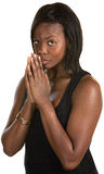 Cautious Black Woman. Cautious young black woman with palms together Royalty Free Stock Photos