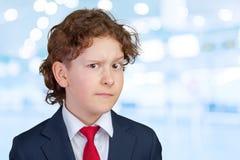 Cautious child boy. Closeup up portrait of s suspicious, cautious child boy Royalty Free Stock Image