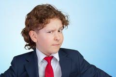 Cautious child boy. Closeup up portrait of s suspicious, cautious child boy Stock Photo