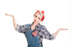 Cautious retro woman gestures defeat, space for text, isolated on w Royalty Free Stock Photography