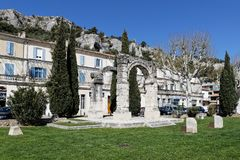 Cavaillon roman arch in town center. CAVAILLON, FRANCE, April 6, 2018 : Cavaillon center. The city is main town of the Regional and Natural Park of Luberon and Royalty Free Stock Photos