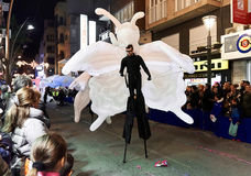 Cavalcade of the Magi parade. Torrevieja, Spain - January 5, 2017: Artist walk on stilts at Cavalcade of the Magi parade The night of the Three Wise Men in Stock Image