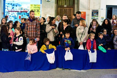 Cavalcade of the Magi parade. Torrevieja, Spain - January 5, 2017: Children waiting for a candies in Cavalcade of the Magi parade or The night of the Three Wise Stock Photo