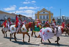 Cavalcade in Ribeira Grande, Sao Miguel island, Azores, Portugal. RIBEIRA GRANDE, AZORES, PORTUGAL - JUNE 29, 2017: Traditional cavalcade on central street of Royalty Free Stock Photos