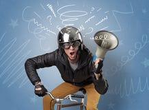 Cavaleiro louco na bicicleta foto de stock