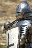 Cavaleiro na armadura de brilho/histórico Foto de Stock Royalty Free