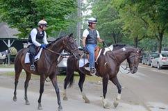 Cavaleiros do cavalo do exercício, Saratoga Springs, NY, Tom Wurl Fotografia de Stock