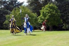 Cavaleiros Jousting, guerreiros, cavalos de equitação dos lutadores Foto de Stock Royalty Free