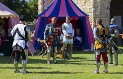 Cavaleiros na batalha Exposição medieval Warkworth, Northumberland inglaterra Reino Unido Imagens de Stock Royalty Free