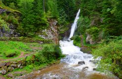 Cavalese waterfall in a valley Val di Fiemme. Royalty Free Stock Photos