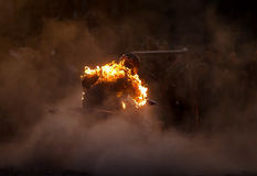 Cavaliere ardente una bici del quadrato Immagine Stock