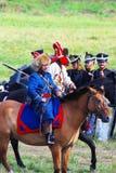 Cavaliere del cavallo in cappello blu di pelliccia e del costume Fotografie Stock