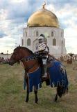 Cavaliere del ferro sul cavallo Fotografia Stock Libera da Diritti