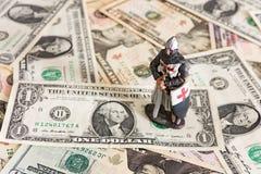 Cavaliere e dollari immagini stock