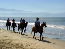 Cavalieri della spiaggia Immagini Stock
