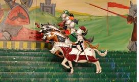 cavalieri sul gioco del cavallo Immagine Stock
