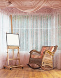 Cavalletto di legno e composizione di vimini nella sedia di oscillazione Immagini Stock