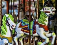 Cavalli antichi del carosello con le strutture aggiunte Immagini Stock Libere da Diritti