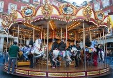 Cavalli del carosello nella città Fotografia Stock Libera da Diritti