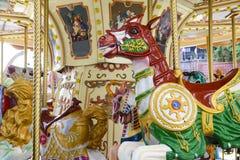 Cavalli di legno di girotondo d'annata Immagine Stock