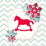 Cavallino rosso del giocattolo con i fiocchi di neve astratti su beige Immagine Stock