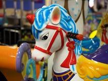 Cavallo bianco sul carosello del bambino Immagini Stock Libere da Diritti