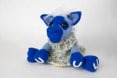 Cavallo blu del giocattolo in un regalo Immagine Stock Libera da Diritti