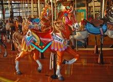 Cavallo brillantemente dipinto del carosello Immagini Stock