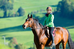 Cavallo da equitazione della donna Fotografia Stock Libera da Diritti