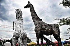 Cavallo di ferro del robot e giraffa Fotografia Stock Libera da Diritti