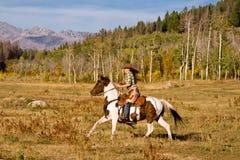Cavallo di guida della donna Fotografia Stock