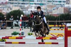 Cavallo di volo in una concorrenza con luce stupefacente Fotografia Stock