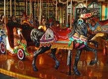 Cavallo nero del carosello con coniglio Immagini Stock Libere da Diritti