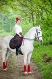 Cavalo de equitação bonito da menina Fotografia de Stock