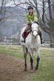 Cavalo de equitação bonito da rapariga Fotos de Stock Royalty Free